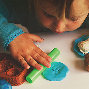 Young toddler with playdough